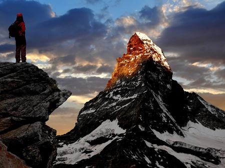 girl looking at the beautiful Mount Matterhorn in the Swiss Alps photo