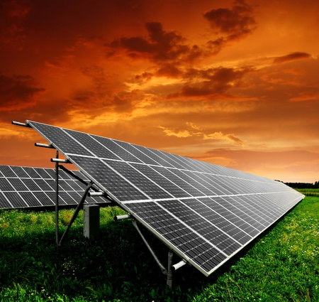 modern generation: Solar energy panels in the setting sun  Stock Photo