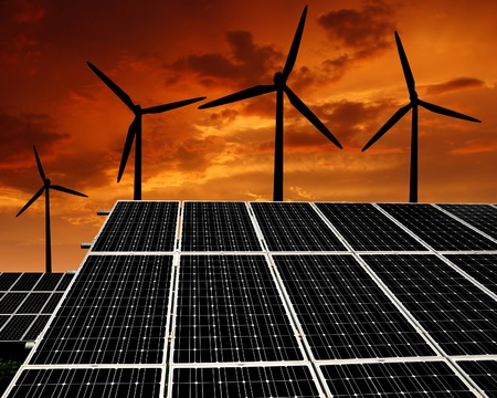 silicium: Solar energy panels and wind turbine in the setting sun