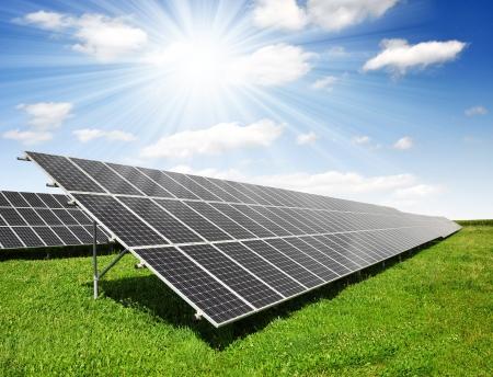 energy costs: Solar energy panels against sunny sky