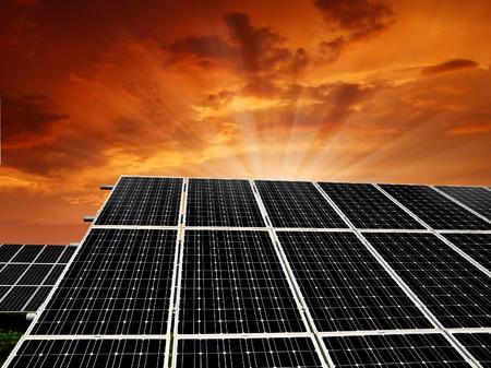 Alternativ: Solar energy panels in the setting sun  Stock Photo