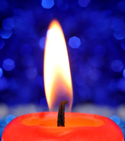 Closeup of a burning red candle Stock Photo - 11287298