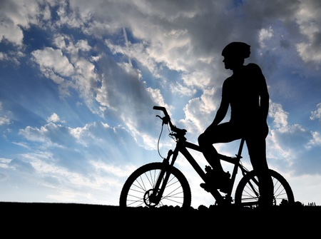 biking: mountain biker silhouette in sunrise