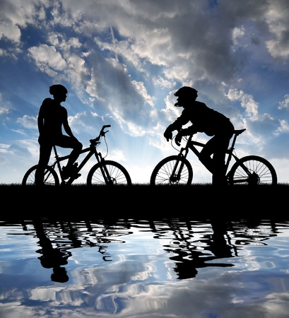mountain bikers silhouette in sunset Stock Photo - 11744046