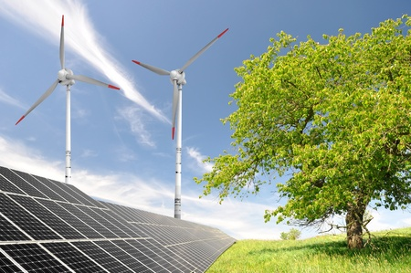 outdoor electricity: solar energy panels and wind turbine Stock Photo