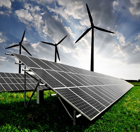 wind power plant: solar energy panels and wind turbine Stock Photo
