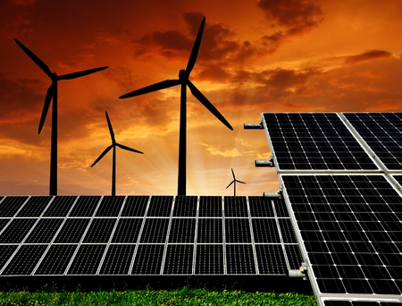 Solar energy panels and wind turbine in the setting sun  Stock Photo - 11928996