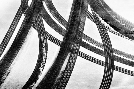 Tracks of car tires in thin layer of first snow  photo