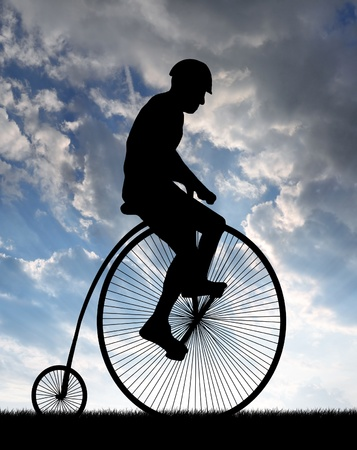 silhouette cyclist on historic  bicycles in the sunset  photo