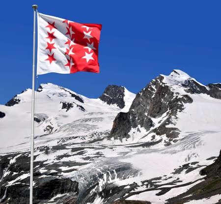 wallis: Strahlhorn,Rimpfischhorn and Allalinhorn with Wallis flag - Swiss Alps Stock Photo