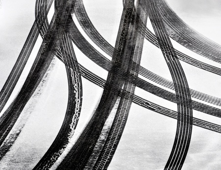 Tracks of car tires in thin layer of first snow Stock Photo - 12725115