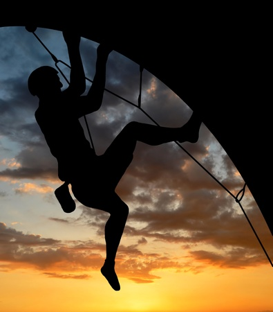 silhouette climber in sunset Stock Photo - 12664949