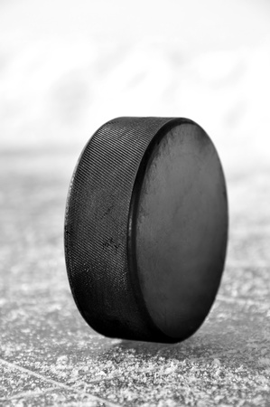 black hockey puck on ice rink Stock Photo - 12724737