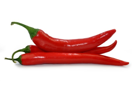 Red hot chilli peppers isolated on white background  photo