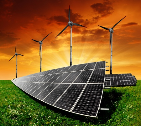 Solar panels and wind turbine in the setting sun  Stock Photo