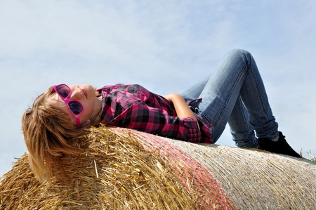the girl lying on the straw bale  photo