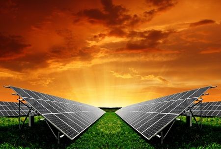 Solar energy panels in the setting sun  Stock Photo