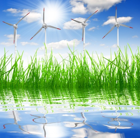 Fresh spring grass with wind turbine  photo