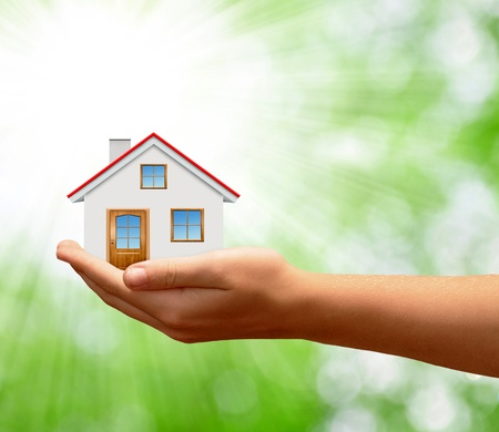 home insurance: The House in the hands Stock Photo