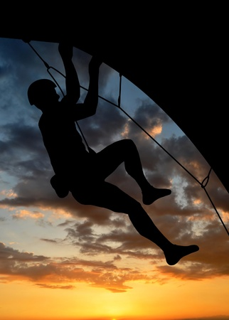 silhouette climber in sunset  photo