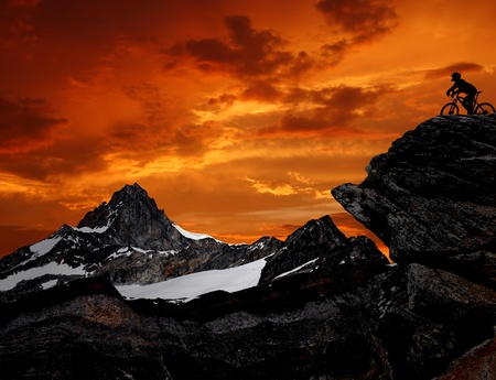 sunup: silhouette of a biker in the Swiss Alps  Stock Photo