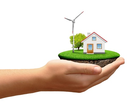recluse: Little island with wind turbines and house in hands on white background  Stock Photo