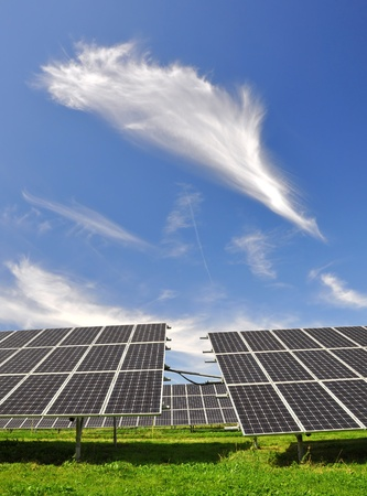 silicium: Solar energy panels against blue sky with clouds