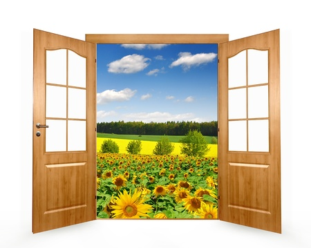 doors open: Open the door to the sunflower field  Stock Photo