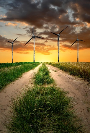 Spring landscape with wind turbine  photo