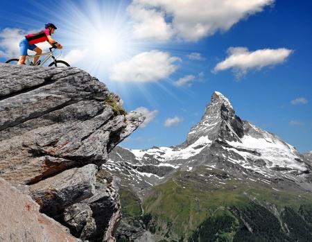 rocky peak: biker in the Swiss Alps