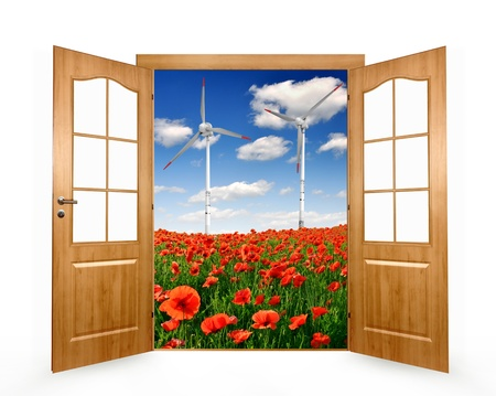 Open the door to the spring landscape with red poppy field and wind turbines  photo