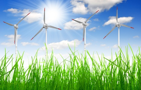 Fresh spring grass with wind turbine  photo