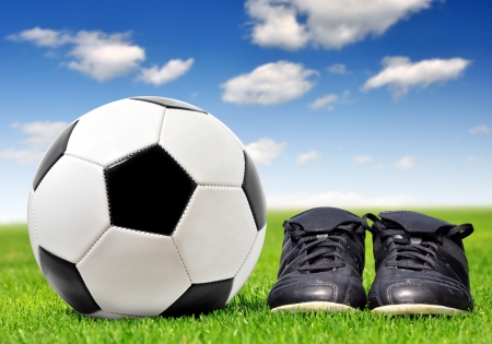 football cleats: soccer ball and shoes in grass
