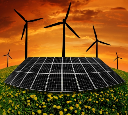 Solar panels and wind turbine in the setting sun Stock Photo - 13811881