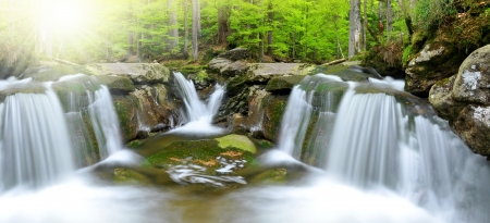 spruit: beautiful waterfalls in spring forest Stock Photo