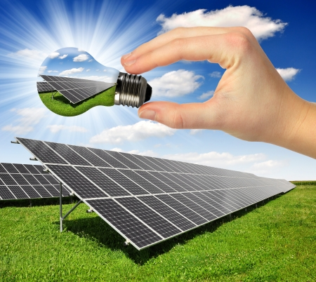 energy fields: Bulb with of solar panel  Stock Photo