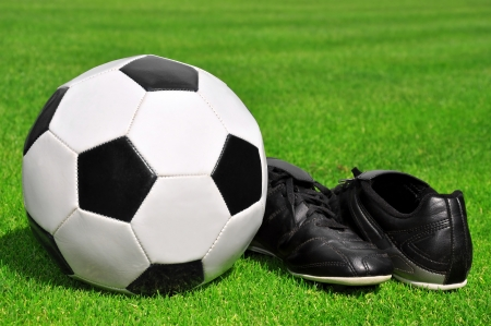 soccer ball and shoes in grass  Stock Photo - 14367121
