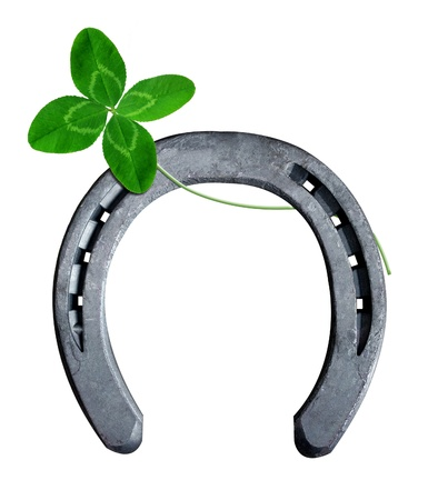 cloverleaf: horseshoe with clover on white background  Stock Photo