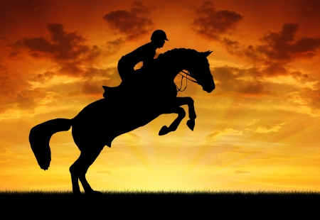 trek: silhouette of a rider on a jumping horse