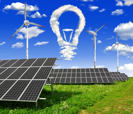 Bulb from clouds above the solar energy panels with wind turbines  photo