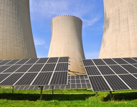 Solar energy panels before a nuclear power plant photo