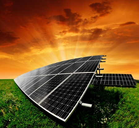 Solar energy panels in the setting sun  Stock Photo