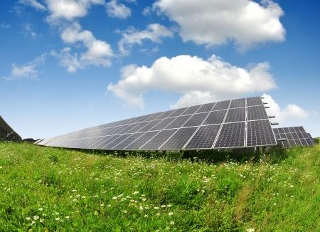 energy costs: Solar energy panels against sunny sky - fisheye shot