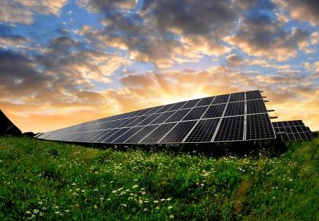 Alternativ:   Solar energy panels in the setting sun