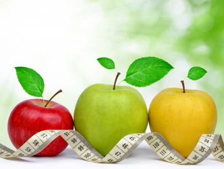 health food: apple collection with measuring tape