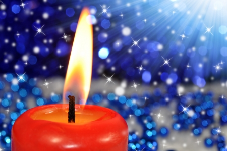 Closeup of a burning red candle Stock Photo - 15334642