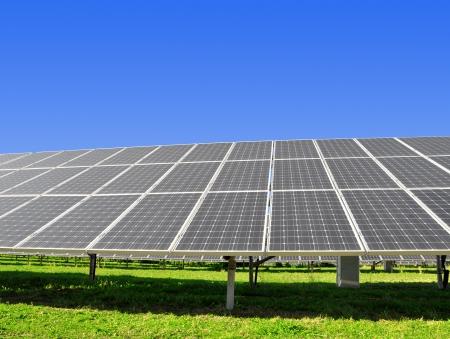 power plants: Solar energy panels against sunny sky