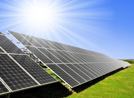 outdoor electricity: Solar energy panels against sunny sky