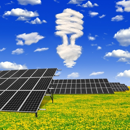 Bulb from clouds above the solar energy panels  Stock Photo