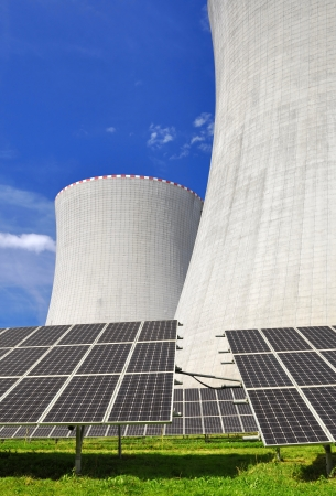 Solar energy panels before a nuclear power plant  Stock Photo - 15700479